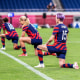 Megan Rapinoe and the United States team take a knee, along with the referee, before kick off during the USA V New Zealand group G match at Saitama Stadium at the Tokyo Summer Olympic Games on July 24, 2021 in Tokyo.