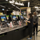 Image: A customer uses a self-checkout kiosk at the Food Le Parc supermarket inside in Hong Kong on May 31, 2018.