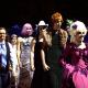 """People participate in the \""""drag ball\"""" halftime show at Burlington High School on Friday, Oct. 15, 2021, in Burlington, Vt.  The event was part of that school's homecoming and was sponsored by the Gender Sexuality Alliance from Burlington and South Burling"""