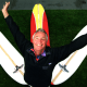 """Image: \""""Y\"""", formerly known at Tom Morey, flashes his signature pose with his new surfboard design. He is ma"""