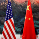Image: A Chinese flag is adjusted before a joint news conference by Chinese Foreign Minister Yang Jiechi and U.S. Secretary of State Hillary Clinton in Beijing on Sept. 5, 2012.