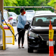 Image: A woman fills her car at a gas station in Annapolis, Md., on May 12, 2021.