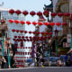 People cross Grant Avenue in Chinatown in San Francisco, on March 25, 2021.