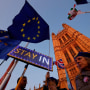 Image: Banners, Union and EU flags are displayed outside the Houses of Parliament in London on Oct. 22, 2019, as MPs debate the second reading of the Government's European Union (Withdrawal Agreement) Bill.