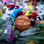 Image: A basketball sits among flowers at a makeshift memorial for Kobe Bryant at Lower Merion High School in Philadelphia on Jan. 27, 2020.