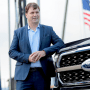 Ford Motor Co. CEO Jim Farley poses next to a new 2021 Ford F-150 pickup truck at the Rouge Complex in Dearborn,Michigan