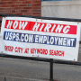 A now hiring sign at the Post Office in Danville