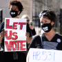 Protesters gather to protest HB 531, which would place tougher restrictions on voting in Georgia, in Atlanta on March 4, 2021.