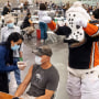 Anaheim Ducks mascot Wild Wing celebrates as a man receives a Covid-19 vaccination at the Anaheim Convention Center in Anaheim, Calif., on March 23, 2021.