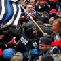 Trump supporters clash with D.C. police officer Michael Fanone at the U.S. Capitol on Jan. 6, 2021.