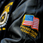 A person in a jacket of the International Brotherhood of Teamsters labor union attends a May Day rally for media workers held by The NewsGuild of New York on International Workers' Day in New York on May 1, 2021.