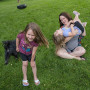 """After working from home with spotty child care throughout the pandemic, \""""I have learned that I can pretty much parent through anything,\"""" Annie Whitlock, seen with her daughters, Maggie, 6, and McKenzie, 3, said."""