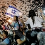 Image: People celebrate after Israel's parliament voted in a new coalition government, ending Benjamin Netanyahu's 12-year hold on power, at Rabin Square in Tel Aviv, Israel