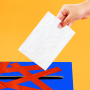 Illustration of a person trying to submit a ballot into a ballot box blocked by red tape.