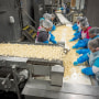 Image: Employees sort peeled garlic cloves at the Christopher Ranch in Gilroy, Calif.