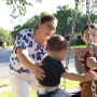 Image: Valerie Villegas plays with her three youngest sons -- Robert Jr., Ayden and Nicholas -- at their Portland, Texas, home. Her husband, Robert Villegas, built the tire swing for the boys in 2020. In late December, 45-year-old Robert contracted covid-