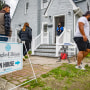 Real estate agents work an open house in West Hempstead, N.Y., on April 18, 2021.