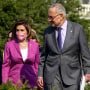 Image: House Speaker Nancy Pelosi and Senate Majority Leader Chuck Schumer arrive at a press conference on climate change at the U.S. Capitol on July 28, 2021.