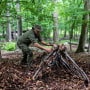 Shane Hobel works on a debris hut shelter at the Mountain Scout Survival School in Hopewell Junction, N.Y., on July 10, 2021.