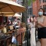 Pedestrians wear masks