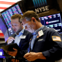 Image: Traders work on the floor of the New York Stock Exchange on July 12, 2021.