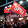 Social Democratic Party supporters react after first exit polls for the general elections in Berlin, Germany, on Sept. 26, 2021.
