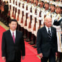 China's then-Vice President Xi Jinping accompanies then-Vice President Joe Biden to view an honor guard during a welcoming ceremony in Beijing on Aug. 18, 2011.