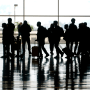 Travelers walk through Midway International Airport in Chicago on Oct. 11, 2021.