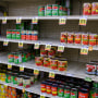 Canned vegetable shelves are partially empty at a Save Mart