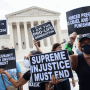 Abortion rights and anti-abortion activists protest alongside each other outside of the Supreme Court on Oct. 4, 2021, in Washington.