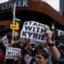 Protesters rallying against Covid-19 vaccination mandates and in support of basketball player Kyrie Irving gather outside the Barclays Center before an NBA basketball game between the Brooklyn Nets and the Charlotte Hornets on Oct. 24, 2021, in New York.