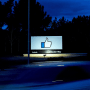 Image:  A car passes by Facebook's corporate headquarters location in Menlo Park, Calif., on March 21, 2018.