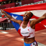Jasmine Camacho-Quinn of Puerto Rico celebrates after winning the gold in the women's 100-meters hurdles final at the Tokyo Games on Aug. 2, 2021.