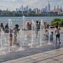 Children play in a water fountain in Brooklyn, N.Y., on June 30, 2021.