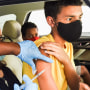 A nurse administers a Covid-19 vaccine to a child at a drive-thru testing and vaccination site in Orlando on Aug. 4, 2021.