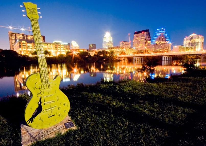 Image: Austin City skyline from Riverside overlooking Town Lake with guitar statue in tribute to local music artists Copyspace. Image shot 2007. Exact date unknown.