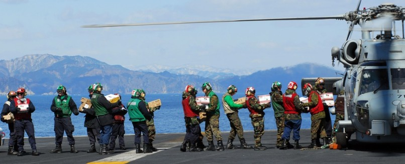 Image: US Navy sailors load humanitarian supplies