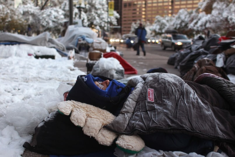 Image: Denver protester sleeps in frost-covered sleeping bag