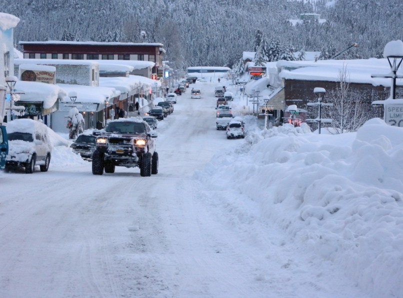 Image: Vehicles move down snow-covered streets in the fishing town of Cordova, Alaska