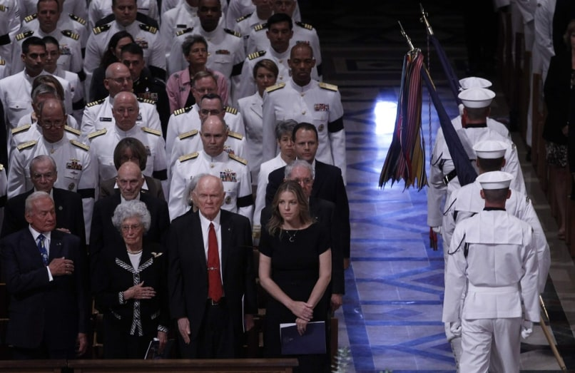 Image: Buzz Aldrin, Annie Glenn, John Glenn and Diana Krall watch an honor guard pass.