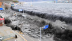 Image: The wave from a tsunami crashes over a street in Miyako City, Iwate Prefecture in northeastern Japan