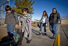 Image: Parent Union organizer Doreen Diaz, right, walks with her daughter and other children to the front door of Desert Trails Elementary in Adelanto, Calif., in Feb. 2012.