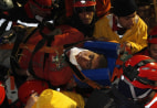 Image: Rescue workers carry 18-year-old male survivor named Imdat from a collapsed building after surviving for more than 100 hours, in Ercis
