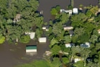 Image: A community of homes is surrounded by floodwaters near Blair, Nebraska