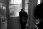 Image: NBC's Brian Williams looks out onto the Rose Garden from the West Wing's Palm Room. He was preparing for the president's arrival and the start of a day spent reporting a behind-the-scenes documentary at the White House