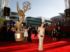 "Image: Nominee actress Sandra Oh from ""Grey's Anatomy"" arrives at the 61st annual Primetime Emmy Awards in Los Angeles"