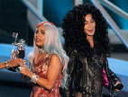 Image: Lady Gaga holds her video of year award with presenter Cher at the 2010 MTV Video Music Awards in Los Angeles