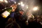 Image: Relatives of the 33 Chilean miners celebrate after the arrival of Luiz Urzúa, the last miner of the group,