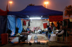 Image: Bahraini protesters sit and rest in their tent at Pearl Square in Bahraini capital of Manama
