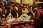 Image: A man, injured from the site of a bomb explosion, is brought to a hospital for treatment in Quetta